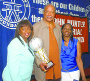 Tom Hoover was presented for Hall of Fame induction by Gwen Connors and Ora Garrett Threat.