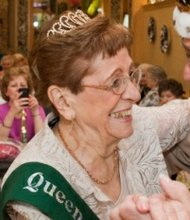 The king and queen of The Timbers of Shorewood retirement community center dance at previous year's prom.
