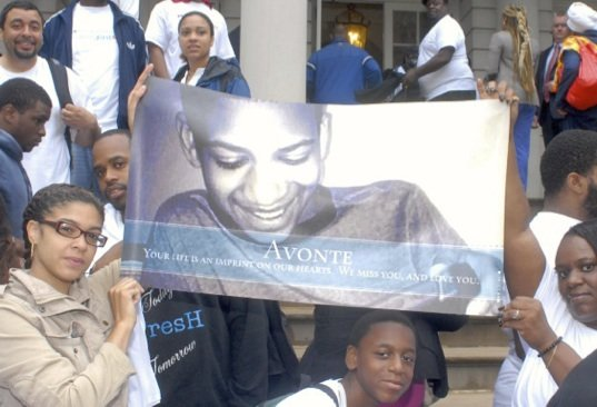 People holding banner for Avonte