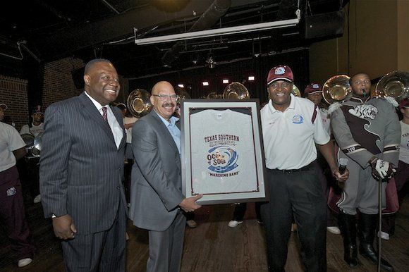 Tom Joyner became an honorary member of the famed Texas Southern University Ocean of Soul marching band June 20 during ...