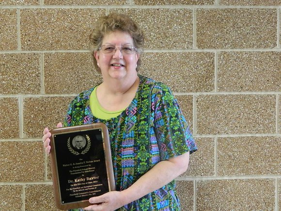 Dr. Kathy Baxter, who spent her entire career at Crystal Lawns School in Joliet, was recognized at Monday night's District ...