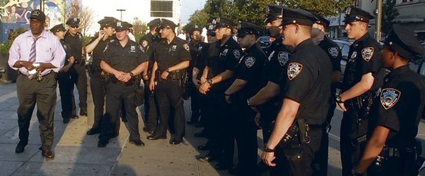 Rev. Vernon Williams walks new recruits through Harlem
