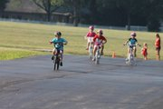 Depending on their age, youngsters will bike either one or two miles as part of the 2014 Mini and Kids Triathalon being held at the C.W. Avery YMCA in Plainfield.