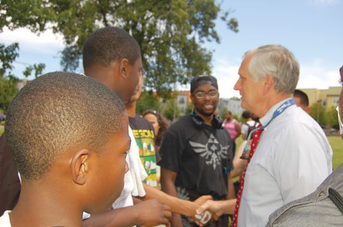 Mayor Charlie Hales visits with local youth Friday during a 'Stop the Violence' demonstration in north Portland's McCoy Park. Days earlier, after a 5-year-old boy was shot in the leg in a suspected gang-related shooting, Hales called gun violence in Portland a 'public safety and a public health crisis'.