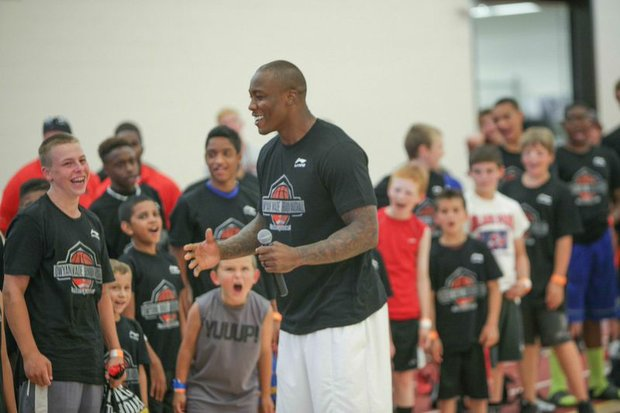 Dwayne Wade the Miami Heat guard and Bears wide receiver Brandon Marshall made several children happy on Tuesday and Wednesday at their Sports Academy in News Lenox, IL. Boys and girls showed their excitement at the opportunity to learn some major moves from the pros.