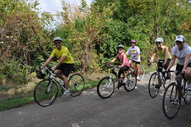 Bike riders follow the trail in the 2013 Cruise the Creek bike ride, sponsored by the Forest Preserve District o of Will County.