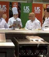 Joliet Junior College student Kristyn Chatlosh confers with judges, who gave her the third highest score in a recent culinary youth Olympics finals competition -- enough to land her a spot on Team USA 2016.