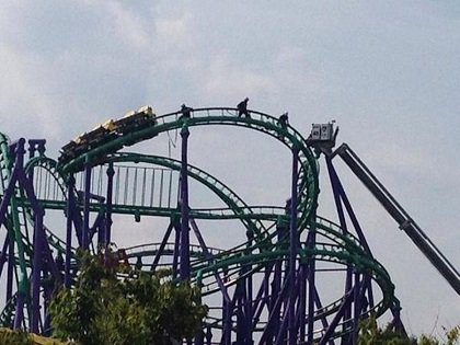 Rescuers pulled stranded riders from a roller coaster at Six Flags America in Maryland on Sunday after the ride halted ...