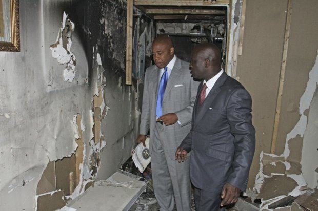 The Rev. Terry Lee showing Brooklyn Borough President Eric Adams some of the interior wall damage