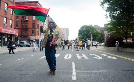 Man waves Pan-African flag as grassroots activists celebrate Marcus Mosiah Garvey's birthday. #HarlemWeek (08/17/2014)