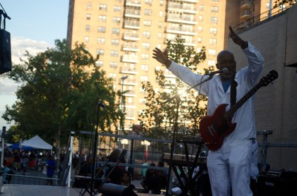 "Lead vocalist, Richard ""Earthman"" Laurent, tears up the stage at Harlem Week 2014."