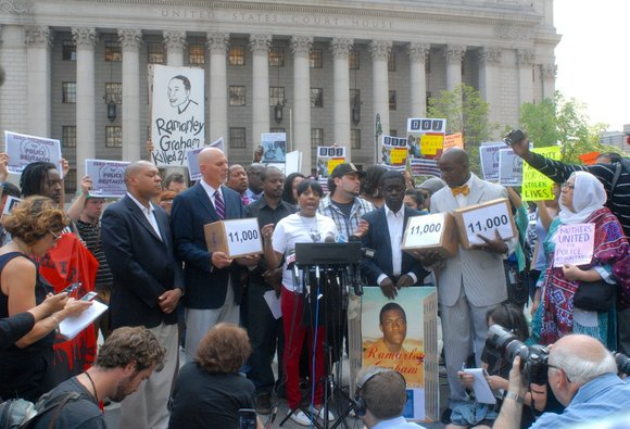 Ramarley Graham's parents, Constance Malcolm and Francelot Graham, held a rally Wednesday to deliver thousands of petitions demanding U.S. Attorney ...