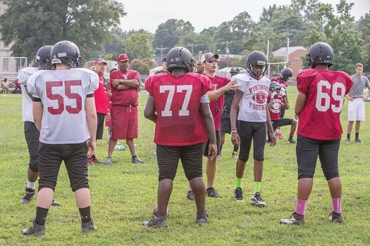 Thomas Jefferson coach Chad Hornik, center in sunglasses, prepares the Vikings for the upcoming season.  The team will travel Aug. 29 to Colonial Heights for its first game.