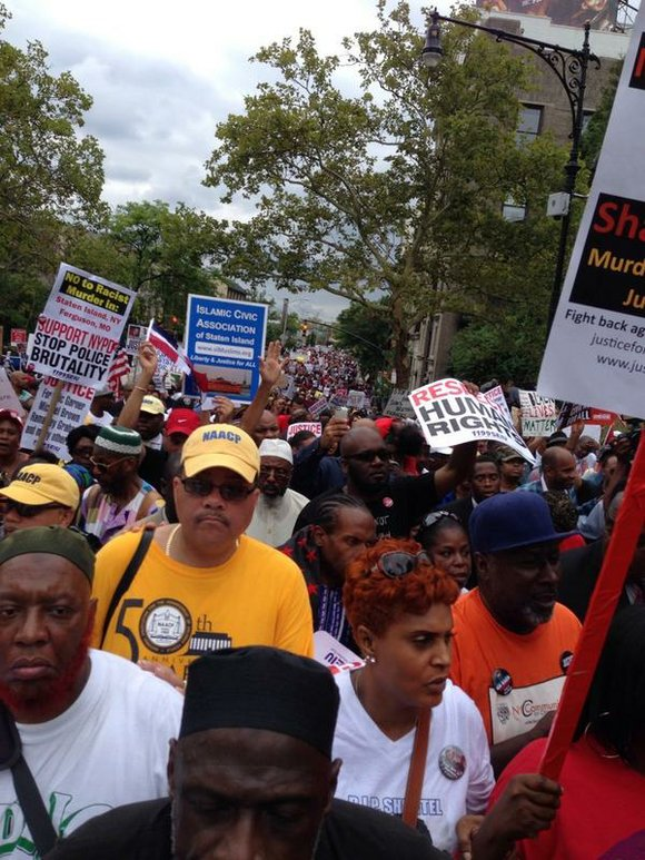 The National Action Network and other groups host a march in Staten Island for Eric Garner that brings out thousands.