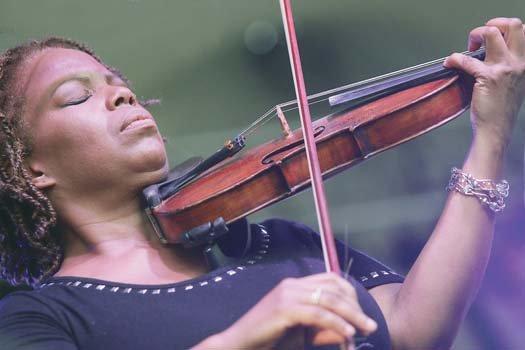 Regina Carter delivers a virtuoso performance on her violin.