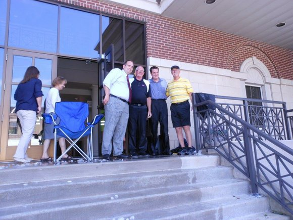 The pair agreed to be doused with ice water Wednesday to raise awareness and money for ALS research, and challenged ...