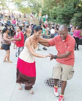 Vanessa Galvez and Alex Adams display some fancy footwork during the Latin Jazz and Salsa Festival at Dogwood Dell in Byrd Park