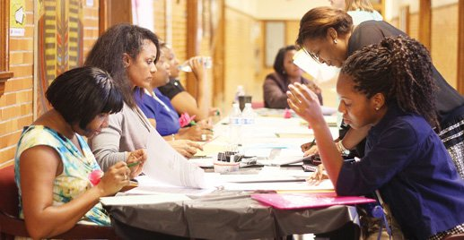 New Richmond teachers read through essential paperwork as they get ready for their debut in city classrooms. They were taking part in a four-day institute designed to prepare them for the start of classes next Tuesday, Sept. 2. Location: Richmond Community High School. More than 200 new instructors took part in the workshops and other sessions focusing on classroom organization and management, relationships and quality instruction.