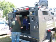 A young girl gets to experience the inside of a military vehicle at last year's Touch-a-Truck event at Galowich YMCA in Joliet.
