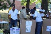Volunteers begin to pack up medical supplies