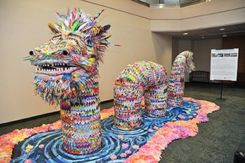 A giant paper dragon, known as Okoa, makes its debut in the lobby of the Main Building at The University ...