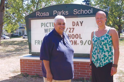 Rosa Parks Elementary Principal Tamala Newsome (left) and assistant principal Reiko Williams pose outside of the north Portland school where students, parents, and administration alike are piloting a year round calendar meant in part to offset some of the 'learning loss' that traditionally comes with months of summer vacation.