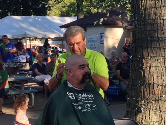 Tom Giarrante, a barber by trade, put is his skills to use at the St. Baldrick's Foundation fundraising event that ...