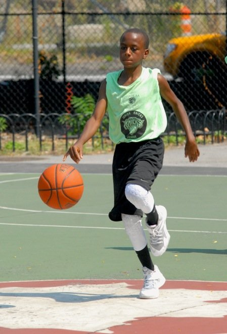 City Wide All-Star li'l guy on a fast run to the hoop. 2014