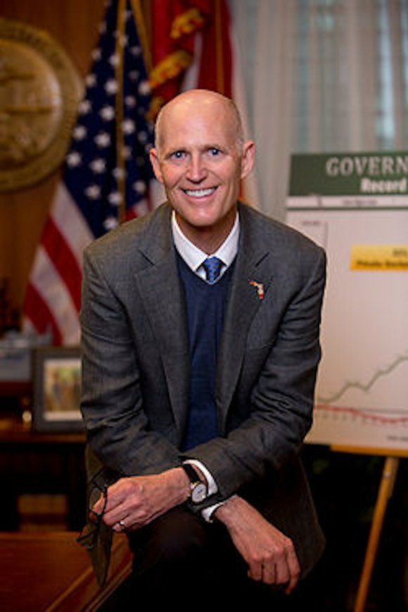 Florida Gov. Rick Scott said Monday that there is nothing nefarious in Donald Trump's suggestion that President Barack Obama has ...
