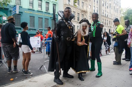 Cosplay was in the air when Black Panther, Storm and Green Lantern all showed at the 2014 African American Day Parade. Sept 21, 2014.