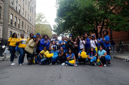 Sigma Gamma Rho pose for a picture after the 2014 African American Day Parade. Sept 21, 2014