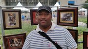 Bryan Collier in front of his illustrations.