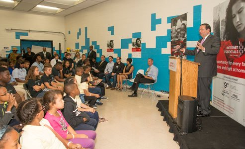 Comcast Executive Vice President David L. Cohen addresses students from Digital Harbor High School and Liberty Elementary School during a special event to announce the extension of its Internet Essentials Program on Monday, September 22, 2014 at Digital Harbor Foundation in Baltimore.