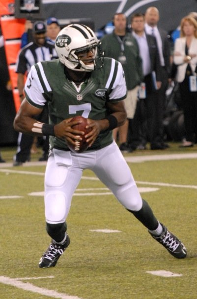 Geno Smith scrambling after a play breaks down.