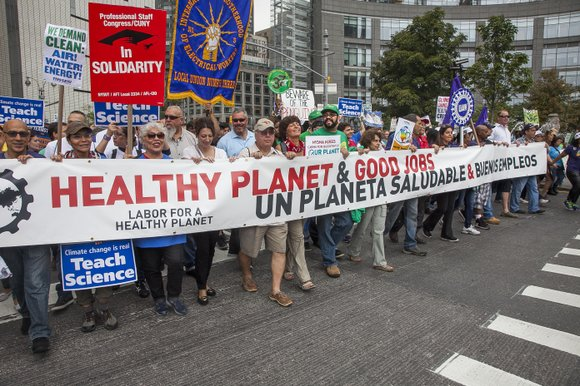 Union leaders, environmental activists and concerned citizens took to the streets of Manhattan Sunday for the People's Climate March, one ...
