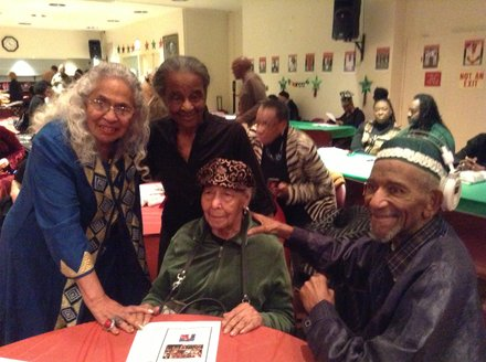 Herman and Iyaluua Ferguson with families of political prisoners at annual dinner.