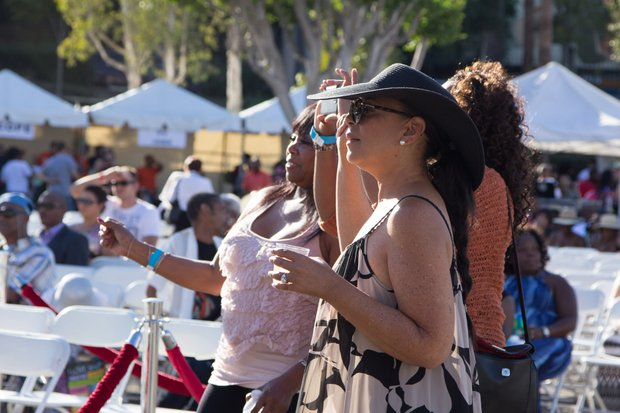 Onlookers get into the beat as the Michael Ward Band performs during the IBEW Local 18 and Baldwin Hills Crenshaw Union Jobs Expo and Celebration which also featured Masta and the Edge of Soul and honored graduates of the IBEW Local 18 & Utility Pre-Craft Training Program.