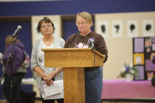 Sherry Anicich, mother of Plainfield murder victim Alisha Bromfield, speaks at the Take Back the Night rally at the Joliet Park District's Inwood Center.