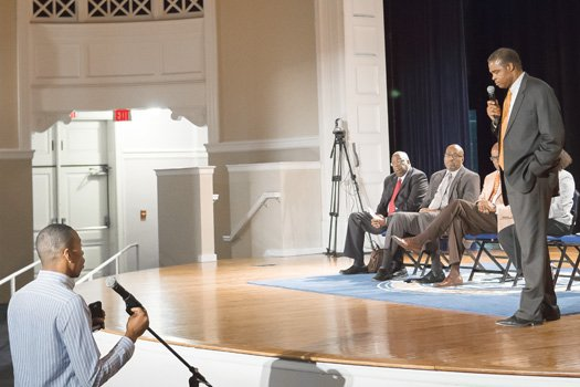 Virginia State University senior Anthony Jackson poses questions to President Keith T. Miller during a town hall meeting with students last Thursday on the Ettrick campus.