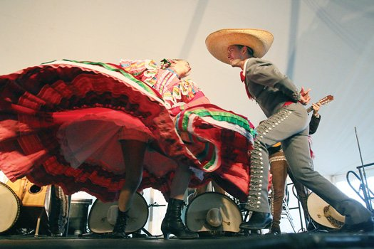 Mexican Mariachi dancers show off fancy footwork during their performance.