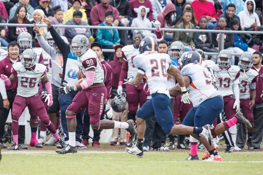 VUU's Darrell Lamb completes a reception as fans and teammates cheer him on. The VUU Panthers were victorious, 78-13.