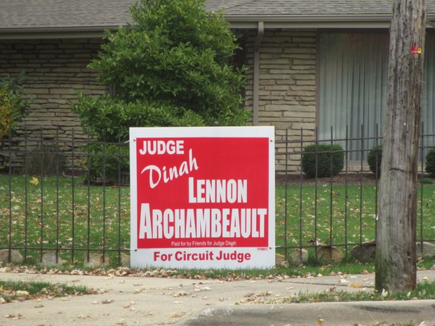 Signs endorsing Dinah Lennon Archambeault's campaign for Will County circuit judge have been posted in the Joliet yard of Will County Associate Judge Robert Brumund.