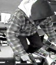 This photo, captured by a surveillance camera, reportedly shows Carl Wilson climbing over a teller counter while robbing a First Midwest Bank in Orland Park.