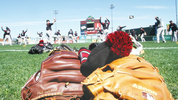 Richmond Flying Squirrels stretch before practice at The Diamond.