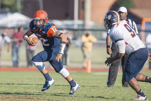 Virginia State quarterback Niko Johnson scrambles down the field during the Trojans' 63-7 homecoming rout of Lincoln University.