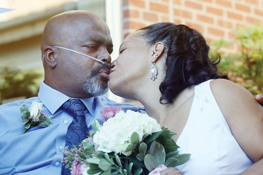 Kent A.P. Smith and Karla Booker seal their union with a kiss Monday. The couple married at Virginia Commonwealth University's Massey Cancer Center, where Mr. Smith is being treated for a brain tumor and lung cancer.