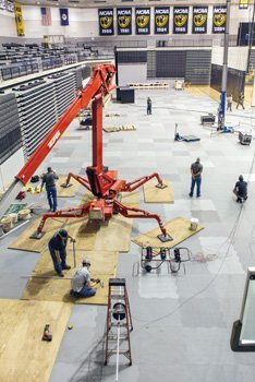 Workers are busy readying the Stuart C. Siegel Center at Virginia Commonwealth University for the start of basketball season, with a free preview of the men's team 5 p.m. Sunday, Oct. 26, at the annual Black & Gold Game. The arena will be enhanced with four new luxury suites, a new scoreboard over center court, installation of a new sound system and new branding marks for VCU and the Atlantic 10 conference. The center's seating capacity will remain about 7,700.