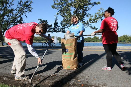 City Council member Parker Agelasto shovels dirt from a road at Byrd Park in the West End. Margaret Quay and Aretha Gayle joined him last Saturday in the HandsOn Greater Richmond citywide cleanup effort. Volunteers teamed in nearly 60 projects to beautify neighborhoods in the annual event.