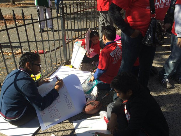 Kids prepare protest signs for the Renters March, 2014.