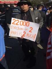 "The sign at the Renters March reads ""22,000 evictions in 2 years is 2 much!"". 10/25/2014"